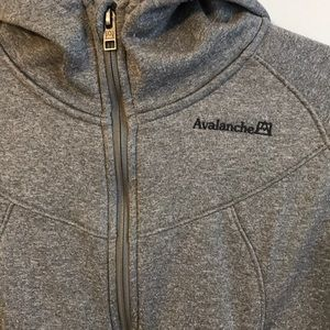 Grey athletic zip up with a hood